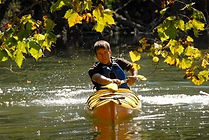Kayaker on the Powell at Well Being Retreat Center