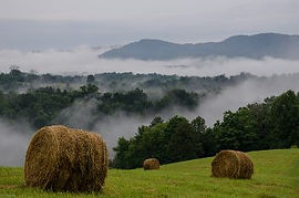 Photo of Top of Hill with Hay Bales at Well Being Retreat Center, Tazewell, TN