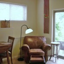 Photo of the sitting area in the Blue Heron Rental Cabin at Well Being Retreat Center