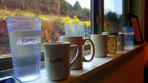 Photo of cups on Retreat Center window sill
