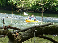 Nick Miller paddling thru rapids on thePowell River at Well Being Retreat Center in Tazewell, TN