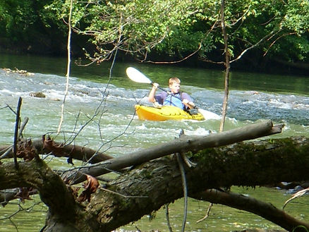 Paddler in swift water on the Powell River in Claiborne County, TN
