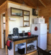 Kitchen in Tiny Houses at Well Being Retreat Center in Tazewell, TN