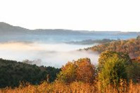 View from the top of hill at Well Being Retreat Center in Northeast Tennessee with fog in the valley below