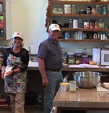 Photo of Don Oakley & Patty Bottari during meal prep at Well Being Retreat Center