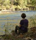 Photo of Meditator sitting by the Powell River