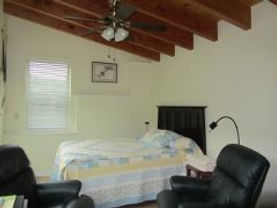 Photo of Queen Bed & Easy Chairs in Chickadee Rental Cabin in Tazewell, Tennessee