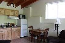 Kitchenette and dining table in Kingfisher Cabin at Well Being Retreat Center