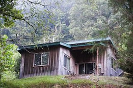 Photo of the earth sheltered Purple Martin Rental Cabin at Well Being Retreat Center