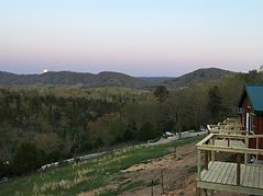 Moonrise over Tiny Houses at Well Being Retreat Center in Tazewell, TN