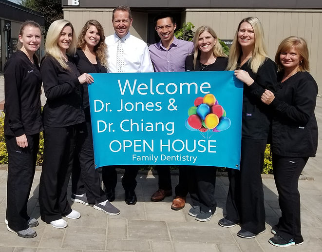 staff open house with banner.jpg