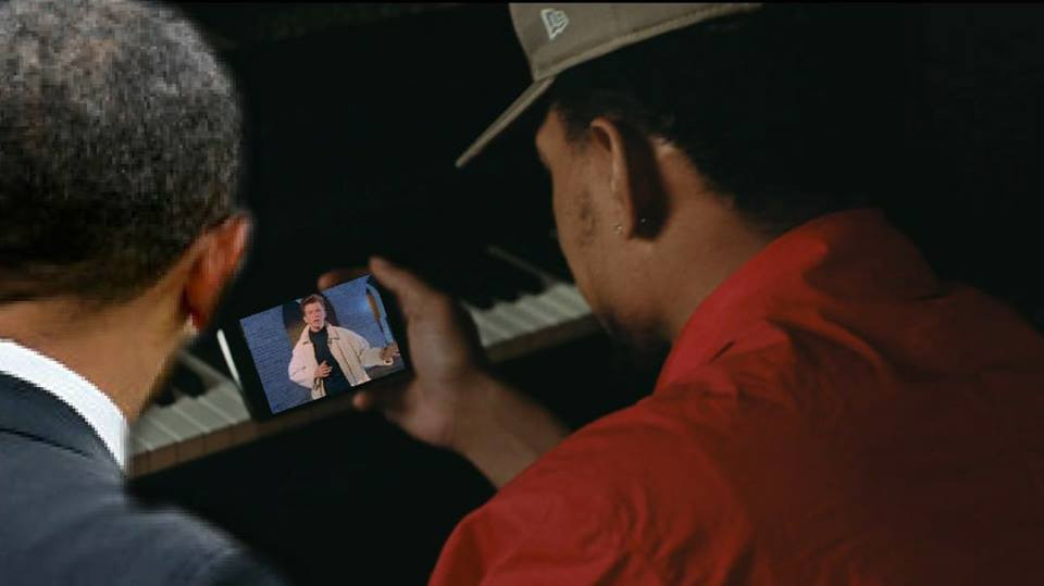 """Chance the Rapper and Barack Obama watch Rick Astley's """"Never Gonna Give You Up"""" on a phone."""