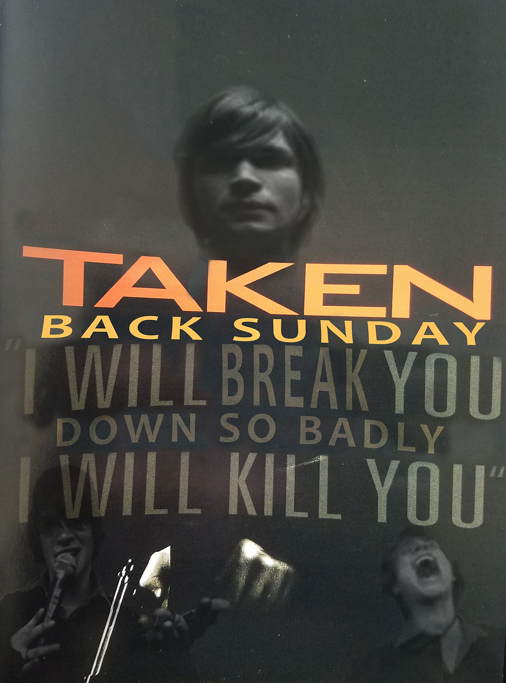 Adam Lazzara poses on the original Taken movie poster