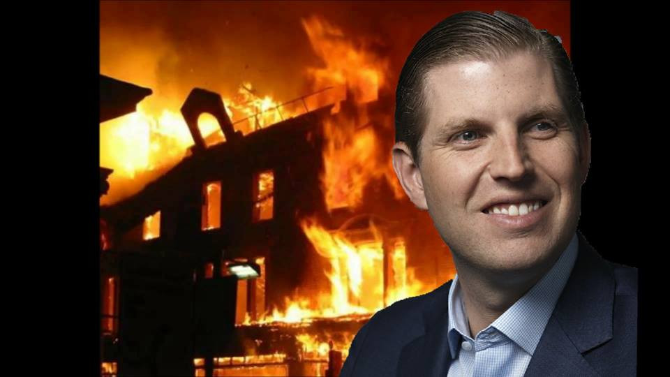 Eric Trump smiles innocently enough as a fire rages on behind him.