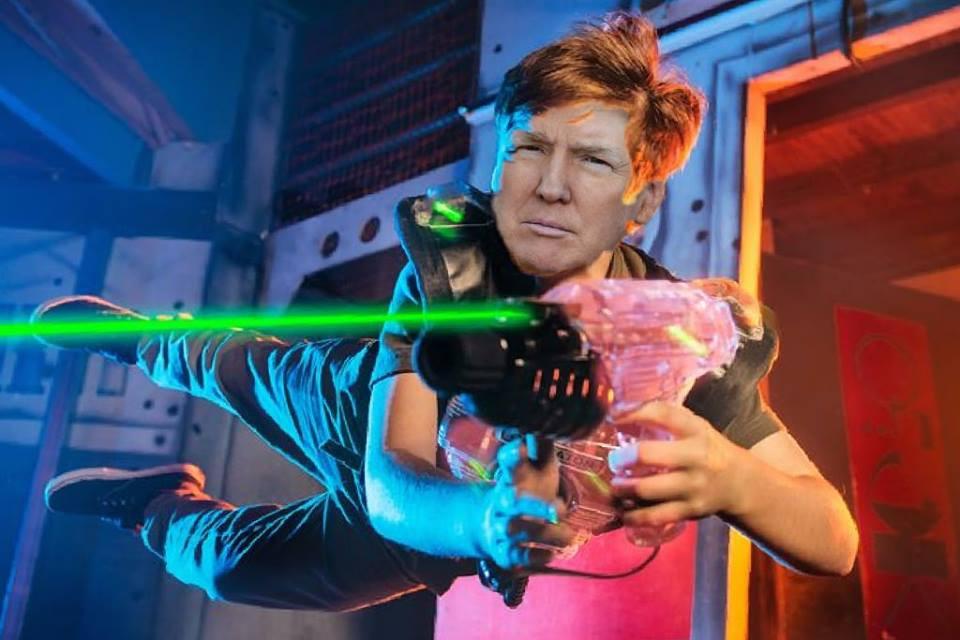 Donald Trump soars through the air, shooting a laser tag gun.