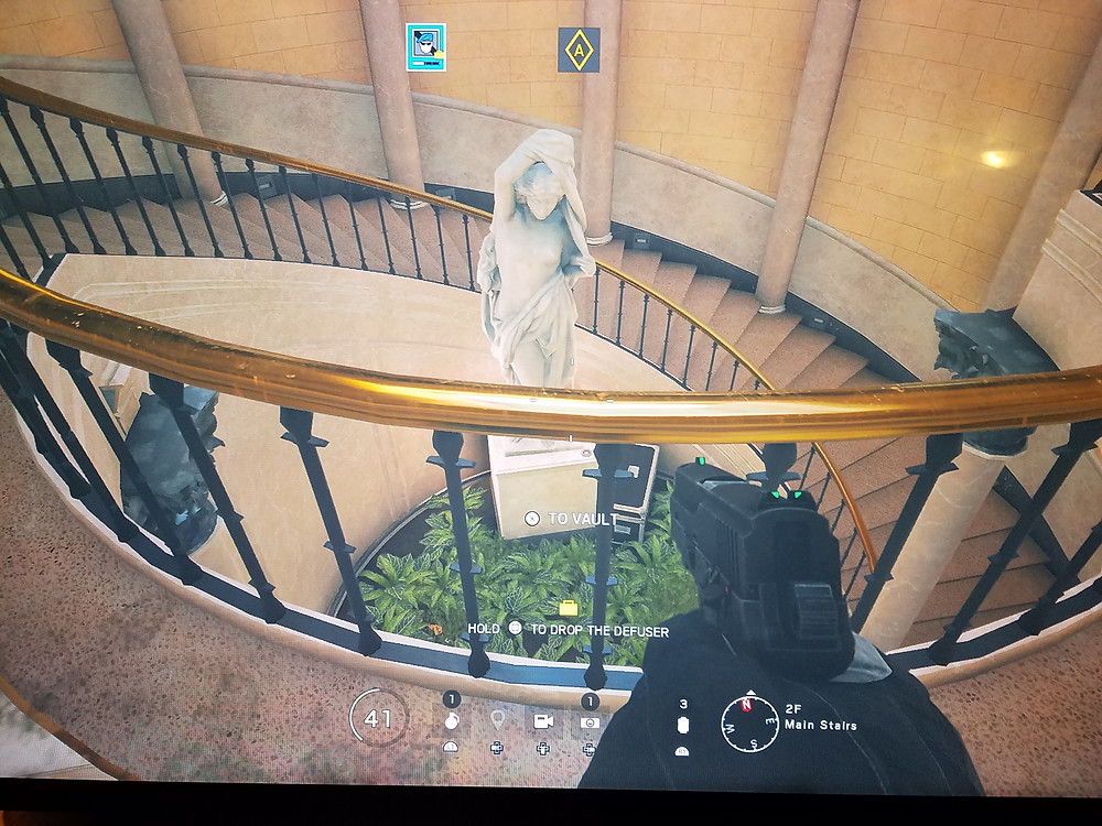 Looking down from the Consulate stairs at a marble statue.