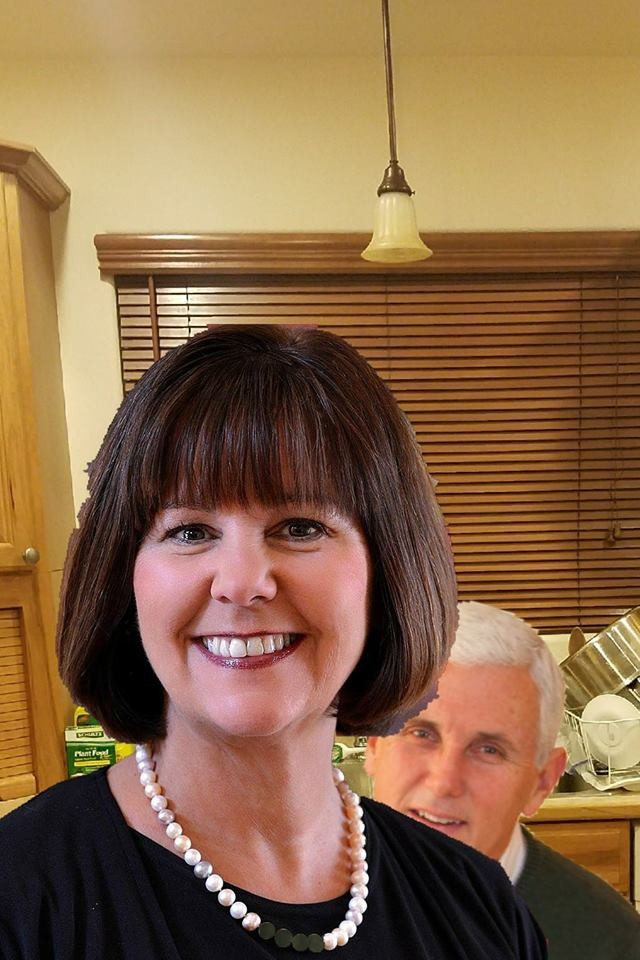 Mike Pence hides behind wife Karen Pence.