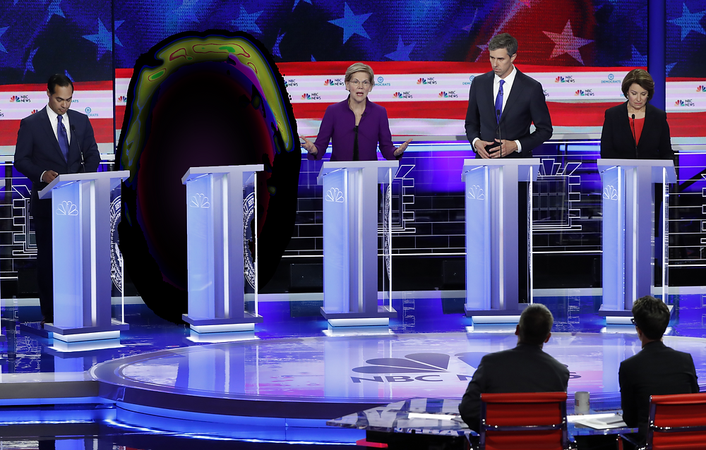 A black hole-looking portal standsd behind a podium at the first democratic presidential debate