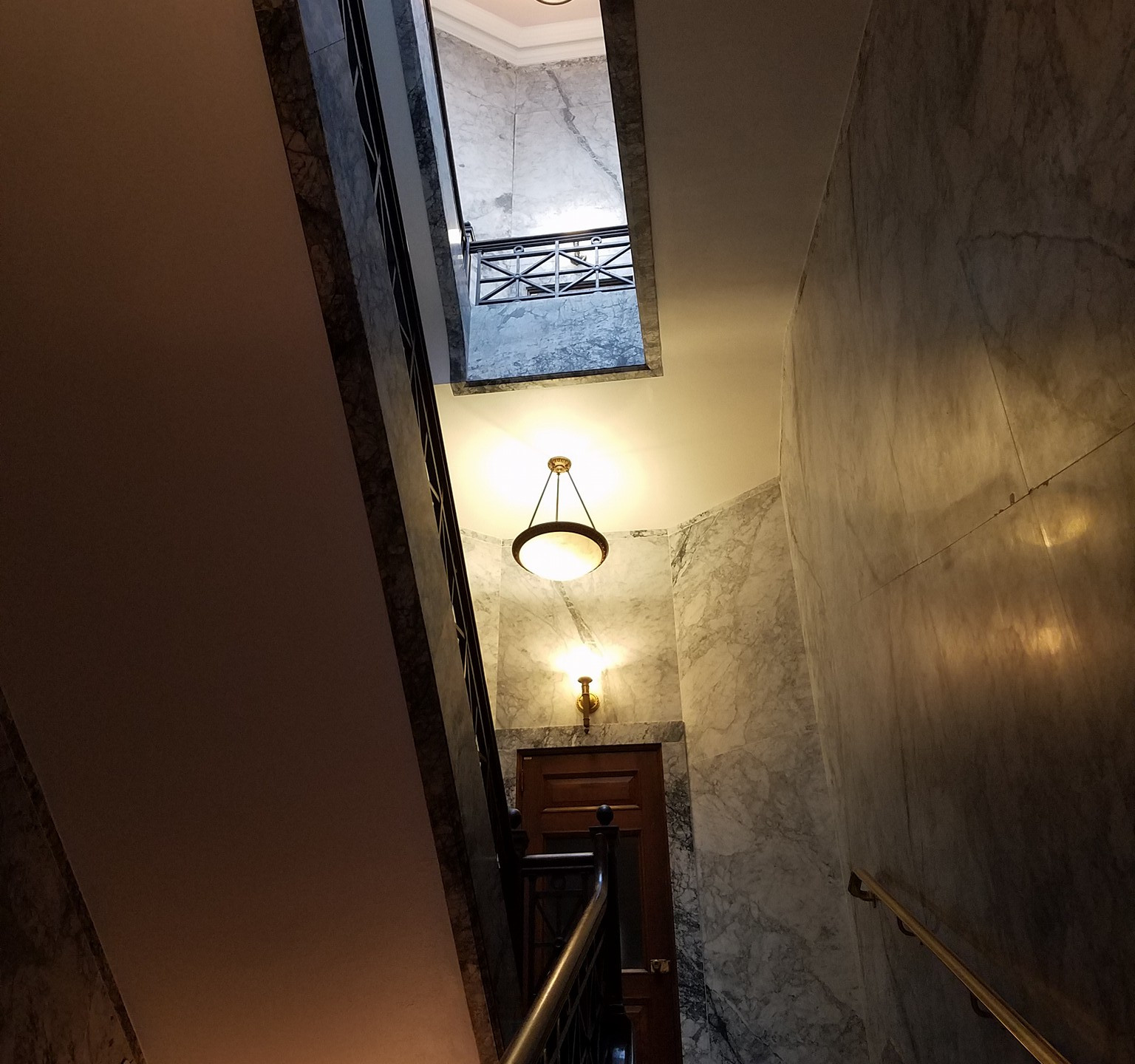 Looking up at the Washington State Capitol stairwell and its light fixture.