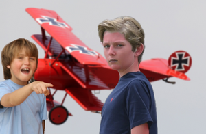 Barron Trump stands in front of the old Red Baron plane, getting mocked by another child.