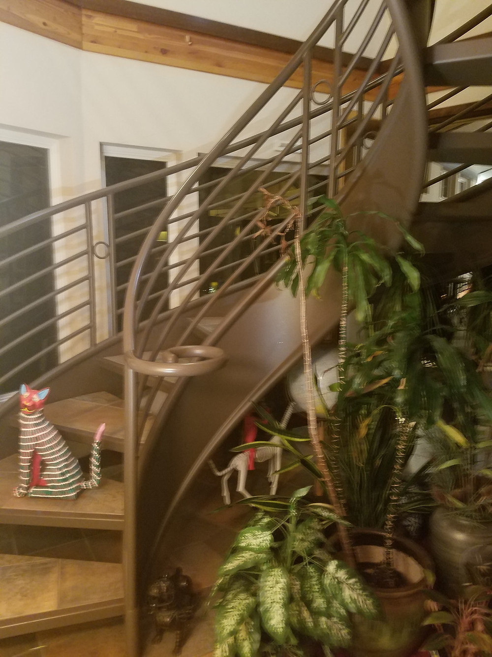 Twisted stairwell guarded by ornamental cat