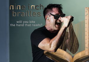 """Trent Reznor wears shades and feels his hands over some braille in a book. The braille is nine inches tall. The text says, """"nine inch brailles: Will you bite the hand that reads?"""""""