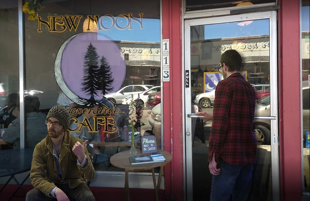 Person attempts to enter New Moon Cafe while a person waiting outside points a thumb at them in awe.