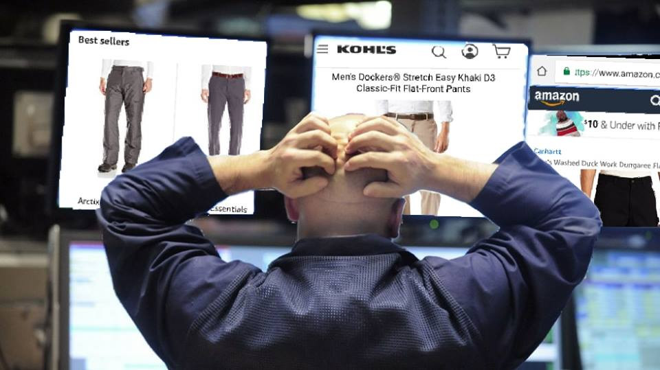 Stock trader pulls at scalp as he searches the internet for pants to buy.