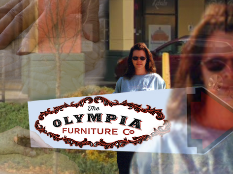 Olympia Furniture Co. Sign Spinner Listening to Job-Mandated Upholstery ASMR