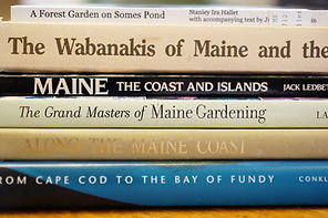 The spines of several books about Maine