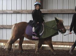 Mei-li Tang, 5, of Eugene, rides Romeo, a Shetland pony