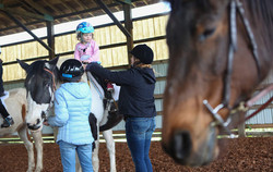Baylee Gregory, 3, rides Kitty the horse. (Kelly Lyon_The Register-Guard)
