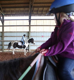 The camp kids practice their trotting in the arena. (Kelly Lyon_The Register-Guard)