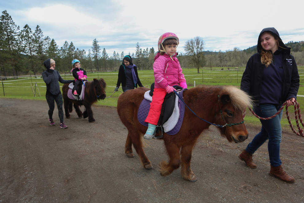 Kids enjoy pony rides during day camp. (Kelly Lyon_The Register-Guard)
