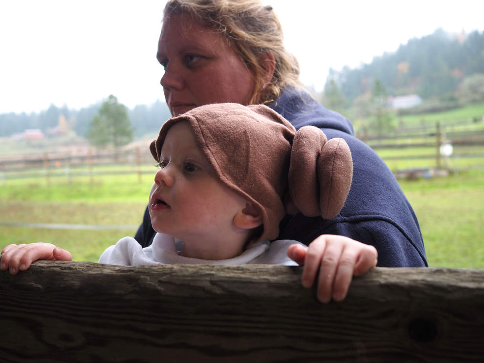 Christine Adams of Eugene, holds onto her leia-dressed daughter, Makayla, 20-months, as they watch