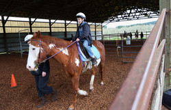 Finnegan Ruef enjoys horse camp at Animal Rescue Teaching For Any Level of Learner. The farm offers