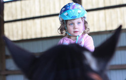Baylee Gregory, only 3 years old, loves to ride horses at the Animal Rescue Teaching For All day cam