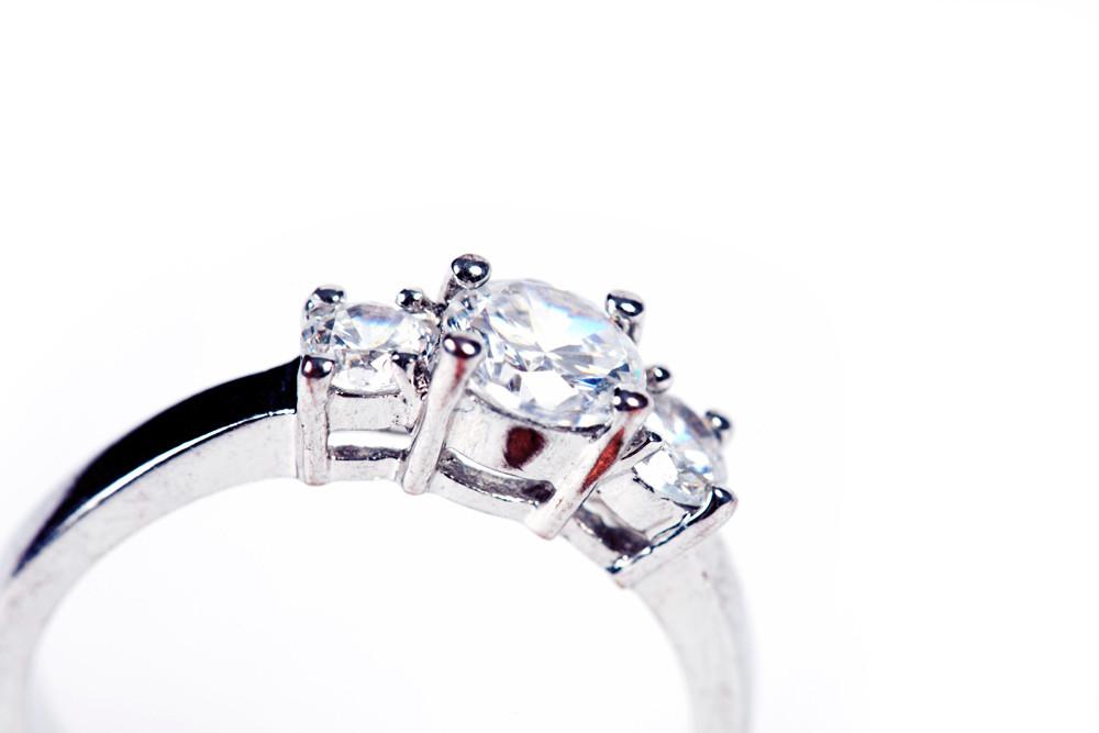 Three stoned diamond engagement ring