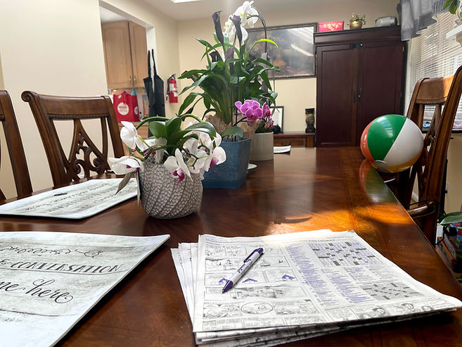 An image of our dining room and dining table, including our daily crossword puzzle.