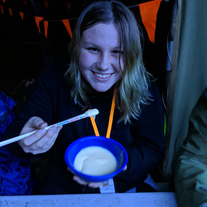 Eating custard with chopsticks!