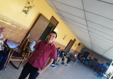 Juan visiting and interacting with the elderly