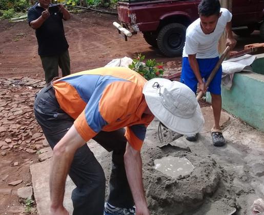Brad mixing concrete