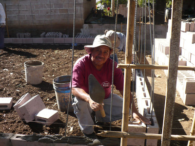 Jorje working on a house.