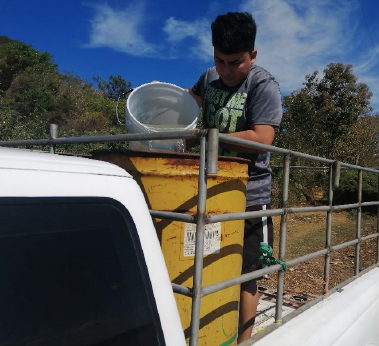 Dennis gathering water for the aquaponics project.