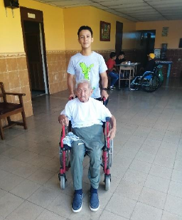Adán visiting and interacting with the elderly