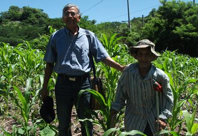 Otoneil helping one of the elder farmers.