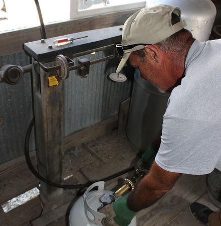 Filling a propane grill bottle