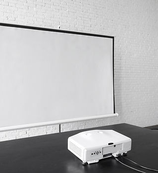 Projector and big screen in office.jpg