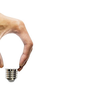 hand holding glowing polygonal lamp on b
