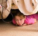 bigstock-The-Child-Hides-Under-A-Bed-V-2